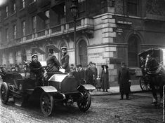 A demonstration of a vacuum cleaner for the London streets, with representatives of the London Corporation in the car, 9 Apr 1913
