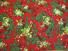 Tablecloth Christmas Design with Holly Branches on Red Background. $29.95, via Etsy.