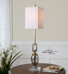 Uttermost Copeland Mercury Glass Buffet Lamp. Speckled mercury glass accented with coffee bronze plated details and a crystal foot. The square hardback shade is an off-white linen fabric.