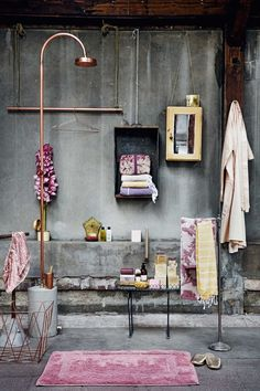 How do you liven up a loft space, and make those dark, heavy walls less masculine and oppressive? Bright pink and boho accents, kilim tapestries and bright happy ephemera gives new life to an old space! The combination of masculine vs. feminine creates an inviting contrast. { photo sources: 1   2   3 }