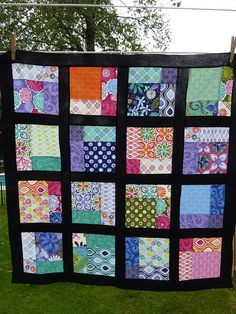 love the squares within each square framed in black in this quilt!