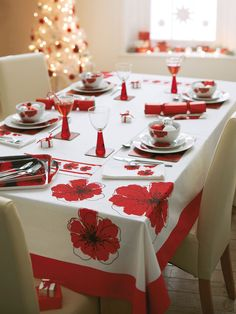Add a splash of red to your Christmas dinner table this year with this amazong Poppies Tablecloth Runner and Napkins Set from #Argos.