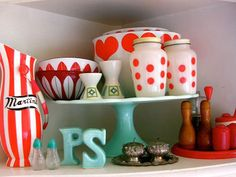 Cute teal cake stand and red accents!