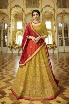 You will definitely earn lots of compliments wearing this designer heavy lehenga choli in mustard yellow wedding lehenga choli paired with contrasting red colored art silk dupatta. Bridal lehenga and choli are silk based paired with art silk fabricated du Heavy Lehenga, Gold Lehenga, Bridal Lehenga, Lehenga Choli Online, Saree, Sabyasachi, Anarkali, Mustard Yellow Wedding, Bridal Jumpsuit