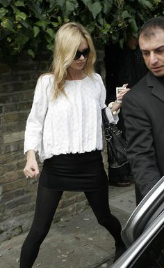 pretty much obsessed with everything she wears. black tights with a floaty top? done