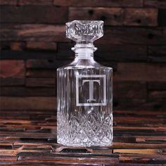 This glass whiskey decanter makes the perfect gift for that classic gentlemen in your life. Designed to evoke 1920s charm, this 34 oz. bottle will be cherished for generations. Great groomsmen gift, best man gift, graduation gift, 21st birthday gift. WE CAN ENGRAVE ANYTHING ON THIS BOTTLE, NOT JUST INITIALS- NO ADDITIONAL CHARGE OR SETUP FEE REQUIRED. SEE OUR OTHER LISTINGS BELOW FOR IDEAS. Size: 3.5 x 3.5 x 9 or 9 cm x 9 cm x 23 cm Holds: 1 Liter…