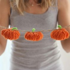 Make a garland from these simple yarn pumpkins or use them as standalone table decor this fall!