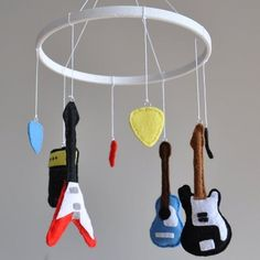 Some kids have animals hanging from their mobile, but yours will have guitars, picks, and amps.