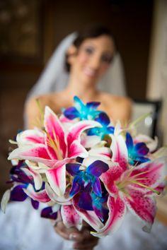Pink stargazer lillies and blue orchid boquet