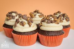 Reese cup cupcakes. I just did a box mix with this AMAZING icing! I also threw on crushed Reese pieces with the Reese cups. Would be great with crushed butterfinger, too! Freeze them before u indulge
