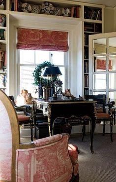 Toile fabric, mirrored French doors, bookcases bracketing window ...