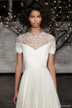 Don't really love the dress, but the model's makeup and hair is gorgeous jenny packham bridal 2014 gemma tea length illusion neckline wedding dress close up