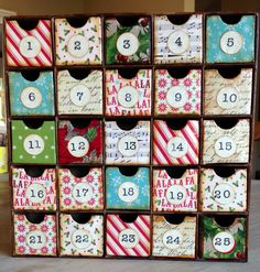 Christmas Advent Calendar.  Craft box is from Hobby Lobby. I decoupaged holiday paper onto the drawers and around the sides of entire box.  Finished with stamped numbers on punched circles.