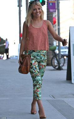 Mollie King in Hawaaian palm-leaf pants.