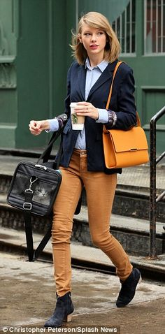 Tomboy chic: She wore a tailored blue blazer, a classic button-down blue shirt that was tucked into a pair of rust-coloured skinny trousers and black ankle boots