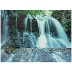 This wall art shows a time-lapsed photograph, giving an ethereal effect to crisp water pouring over cliffs. The canvas print will make a lovely decorative addition to any room in your home.