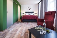 Das Forstzimmer: einer von sieben thematisch gestalteten Räumen im Hotel Grenzhof Heidelberg