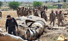 Pak Army personnel guarding the wreckage of Bhoja Airline crashed on yesterday near Lohi Bhair at Hussainabad village about 7 kms away from Benazir Bhutto International Airport carrying 118 passengers flying from Karachi to Islamabad.