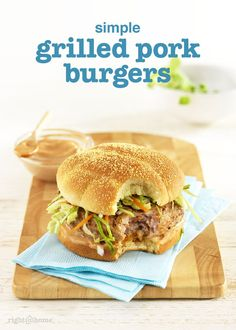 These light and juicy grilled pork burgers feature barbecue mayo and cabbage-carrot slaw as toppings!