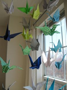 An idea for all the paper cranes my sister made when WeeOne was born. (I think I'll thumbtack single threads to the ceiling instead of a mobile though)