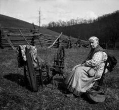 Grandma Rice with spinning wheel, basket, woven spread, and dulcimer. :: Jean Thomas, The Traipsin' Woman, Collection
