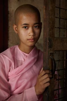 Young Monk in the Yangon / Myanmar country. The poverty is critic in Myanmar and some boys and young teen prefer go lives in the Monastery of Monk.