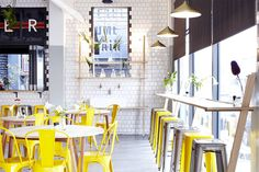 superette_cafe yellow chairs subway tile