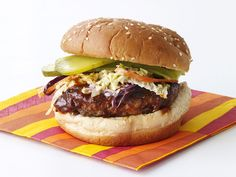 Dallas Burger  Bobby brings big Texas flavor to this burger, with a zesty spice rub and homemade, finger-lickin' barbecue sauce. Creamy coleslaw cuts through the spice and pickles add tartness.
