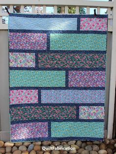 The quarter cut free quilt pattern comes together quickly and easily for a fantastic stash busting quilt to give or to keep!
