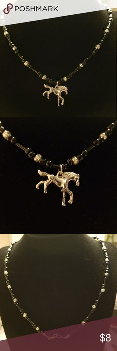 """Petite Horse Necklace Petite silver tone horse necklace. On a matching black and silver 20"""" glass beaded chain. Has a lobster claw clasp (pendant cannot be removed from the chain) Jewelry Necklaces"""