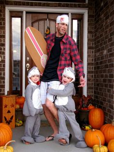 Shark costume with attacked surfer. Super funny Halloween costume idea.