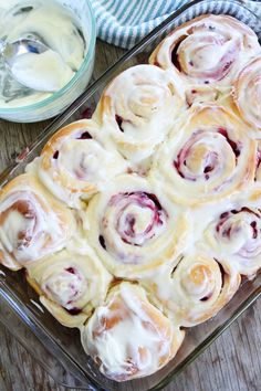Raspberry Sweet Rolls Recipe on twopeasandtheirpod.com Soft and sweet raspberry yeast rolls topped with cream cheese frosting. These rolls are amazing!
