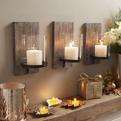 love these wall mounted candles