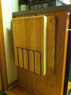 Mount a wire magazine rack (open on both ends) to the side of a kitchen cabinet to create a neat organizer for large cutting boards and pastry boards.