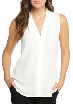 Calvin Klein Women's Pleated V-Neck Blouse. The Pleated V-Neck Blouse by Calvin Klein is crafted with a loose, sleeveless silhouette that helps it pair perfectly under your favorite jackets and blazers. Casual Tops For Women, Blouses For Women, Silk Cami Top, Neon Shirts, Dragon Ball Z Shirt, White Sleeveless Blouse, Professional Wear, Petite Tops, White V Necks