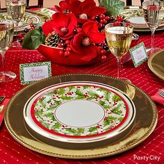 Reusable metal chargers lend elegance to pretty paper Christmas plates, without creating a pile of dishes. :)