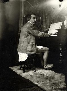 Paul Gauguin playing the harmonium in Alphonse Mucha's studio at rue de la Grande-Chaumière, Paris, 1893