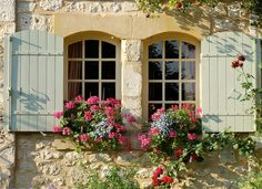 Beautiful old windows, barn windows, or a European window with shutters painted in perfect spring colours like aqua marine, soft yellows over the brick or stone! Both antique windows with the 'new addition' of mullions are perfectly set off with fantastic window boxes with delicious strong pink geraniums and ivy... Bring the Spring!