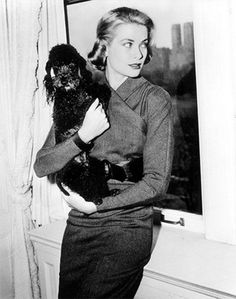 Princess Grace of Monaco, posing with her black poodle Oliver in 1956