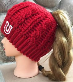 A personal favorite from my Etsy shop https://www.etsy.com/listing/508216375/team-spirit-messy-bun-beanie