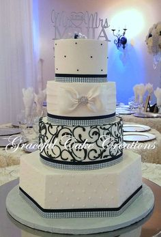 https://flic.kr/p/22FLAH8 | Elegant White Butter Cream Wedding Cake with Navy Blue and Rhinestone Bling Ribbon