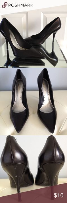 BCBG Classic Black Heels You can go wrong with this closet staple!!!  classic and timeless, this pair of black heels is in good shape from outward appearances but note the heels have multiple nicks but not noticeable during wear.  Just obvious during close up inspection which is reflected in price. BCBGirls Shoes Heels