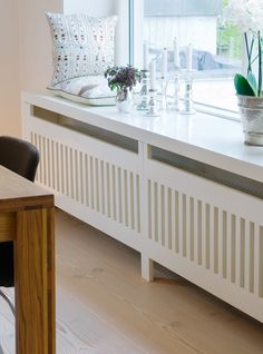 Use these radiator cover ideas to transform your room. See how to use a radiator cover for storage, reading nooks under windows, corner cabinets + more. Functional Furniture, Home Radiators, Radiator Cover, Home Living Room, Apartment Living, Home Projects, House Design, Interior Design, Home Decor