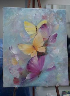 Purple and yellow butterfly painting against sweet blue background.