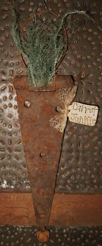 Carrot from an old rusty door hinge. Or turn it upside down for a Christmas tree.