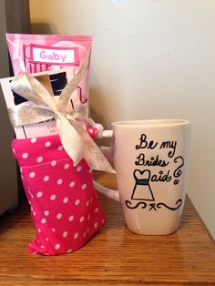 Will you be my bridesmaid?  Took all my gals to Starbucks and filled these mugs with their favorite Starbucks beverage. Also sewed the polka dot cinch bags and added a lotion and perfume sample. Costed about 8 dollars per girl for the mug, lotion, bag and coffee :)