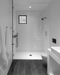 The minimalistic bathroom at the center of the studio separates the sleeping area from the living area . Photo 10 of 13 in Retreat in the Aspen Grove