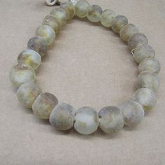 22 pieces of recycled glass beads from Ghana. Main colour is Brown Wholesale price Shipping time 2 weeks to customer Recycled Glass, Main Colors, Ghana, Fair Trade, Glass Beads, Beaded Bracelets, Buy And Sell, African, Brown