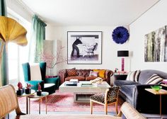 Colorful living room with a juju hat hung high!