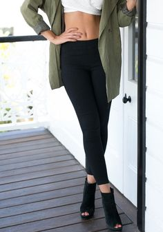 This black classic high-waist leggings features two back pockets and an elastic waist for that figure-flattering look. Own one here. | Lookbook Store